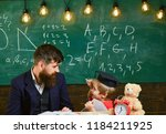 kid studies individually with... | Shutterstock . vector #1184211925
