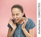young funny woman sneezing with ... | Shutterstock . vector #1184217352