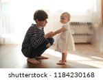 the elder brother cares with... | Shutterstock . vector #1184230168