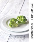 fresh broccoli on the white... | Shutterstock . vector #1184235262