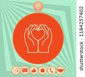 hands holding heart  ... | Shutterstock .eps vector #1184257402