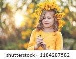 cute little girl with wreath of ... | Shutterstock . vector #1184287582