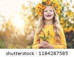 cute little girl with wreath of ... | Shutterstock . vector #1184287585