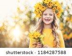 cute little girl with wreath of ... | Shutterstock . vector #1184287588
