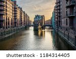 famous historic warehouse... | Shutterstock . vector #1184314405