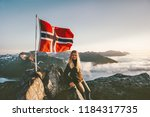 woman and norway flag on... | Shutterstock . vector #1184317735