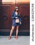street style portrait of an... | Shutterstock . vector #1184329198