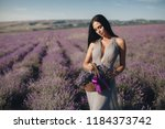 beautiful girl on the lavender... | Shutterstock . vector #1184373742