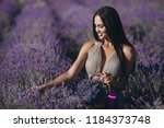beautiful girl on the lavender... | Shutterstock . vector #1184373748