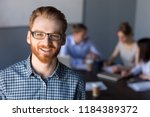 smiling red haired millennial... | Shutterstock . vector #1184389372