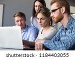 serious team leader explains... | Shutterstock . vector #1184403055