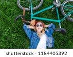 portrait of an attractive... | Shutterstock . vector #1184405392