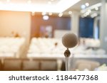 microphone on blurred office of ... | Shutterstock . vector #1184477368