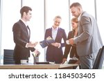 business people standing and... | Shutterstock . vector #1184503405