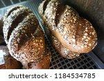 whole grain bread bun with oat... | Shutterstock . vector #1184534785