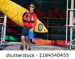 man carries a kayak   Shutterstock . vector #1184540455
