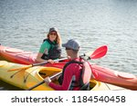 two people in kayaks on the...   Shutterstock . vector #1184540458