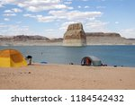 man setting up tent at lone... | Shutterstock . vector #1184542432