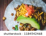 a close up of a vegan taco with ... | Shutterstock . vector #1184542468