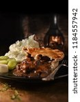 traditional steak and ale pie... | Shutterstock . vector #1184557942