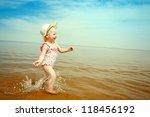 happy small girl running on the ... | Shutterstock . vector #118456192