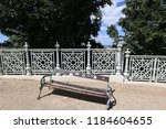 the bench is standing in the... | Shutterstock . vector #1184604655