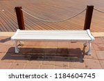 the bench is standing in the... | Shutterstock . vector #1184604745