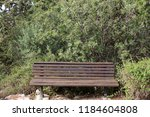 the bench is standing in the... | Shutterstock . vector #1184604808