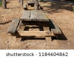 the bench is standing in the... | Shutterstock . vector #1184604862