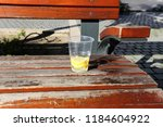 the bench is standing in the... | Shutterstock . vector #1184604922