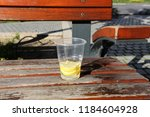 the bench is standing in the... | Shutterstock . vector #1184604928