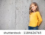 little girl stand and smile at... | Shutterstock . vector #1184626765
