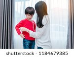 mother dressing up a son for... | Shutterstock . vector #1184679385