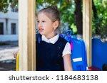 an elementary school student... | Shutterstock . vector #1184683138