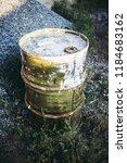 dirty green metal barrel in the ... | Shutterstock . vector #1184683162