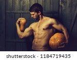naked man with orange halloween ... | Shutterstock . vector #1184719435