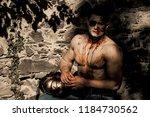halloween man with zombie face... | Shutterstock . vector #1184730562