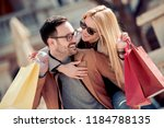 happy young couple holding... | Shutterstock . vector #1184788135