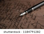 fountain pen on letter with... | Shutterstock . vector #1184791282