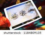 digital tablet with artwork.... | Shutterstock . vector #1184809135