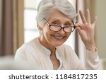 happy retired senior woman... | Shutterstock . vector #1184817235