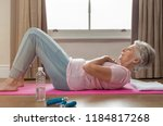 Senior Woman Doing Sit Ups On...