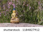 golden buddha statue in a forest | Shutterstock . vector #1184827912