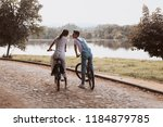 romantic couple riding bicycles ... | Shutterstock . vector #1184879785