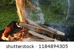 burning brazier with firewood... | Shutterstock . vector #1184894305