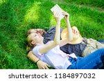 man and girl lay on grass... | Shutterstock . vector #1184897032