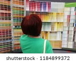 the girl looks at the color map ... | Shutterstock . vector #1184899372