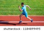 sprinter training at stadium...   Shutterstock . vector #1184899495