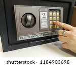 the girl dials the code on the... | Shutterstock . vector #1184903698