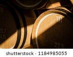 oak barrels. wine barrels... | Shutterstock . vector #1184985055
